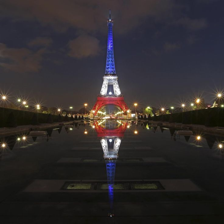 The #EiffelTower lit with the blue, white and red colors of the #Frenchflag is reflected in the #Trocaderofountains in #Paris, Nov. 23, 2015. CREDIT: Christian Hartmann/Reuters SEE MORE at ABCNews.com/photos #abcnews