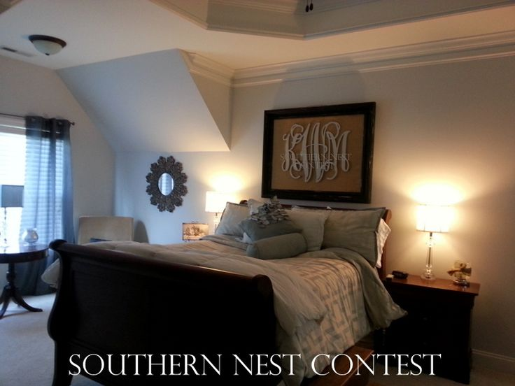 """I hung this Southern Nest Monogram over the bed in the master bedroom. The frame was bought at an antique shop and was painted with a weath..."