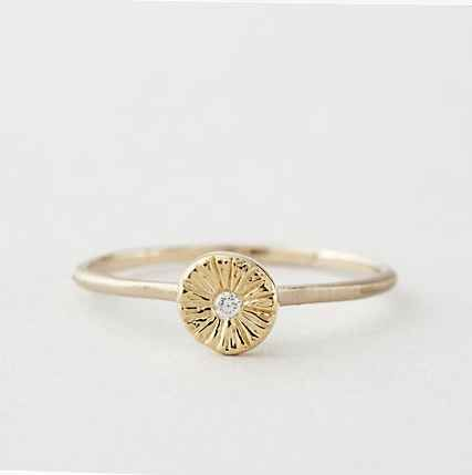 This sunburst diamond ring. | 65 Impossibly Beautiful Alternative Engagement Rings You'll Want To Say Yes To