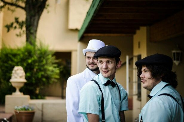 Poorboy hats and suspenders for best men in mint green shirts