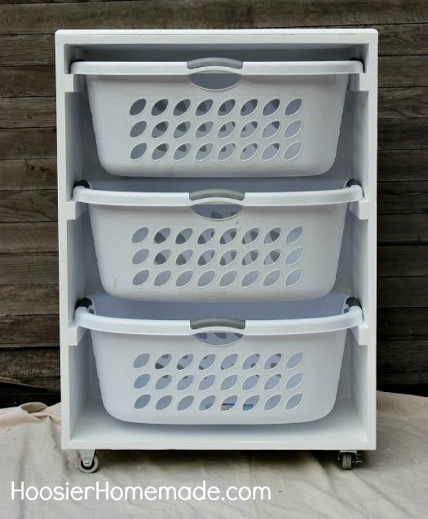 DIY Mobile Laundry Station.  I could make this for the boys for dirty & clean laundry.  Then it would stay seperate... HMMMmmm