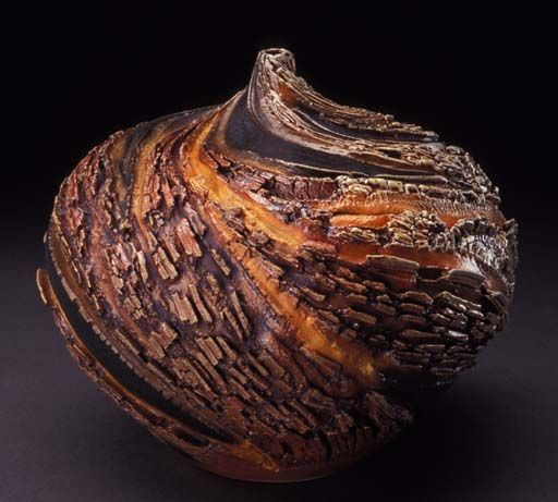 """Carrie Doman Ceramics. """" find endless inspiration for my work in the landscapes of Colorado as well as the landscapes of other countries I have visited. The bark of an exotic tree in Nicaragua, the rugged cliffs along the Italian coastline and the eroding canyon walls of Colorado's Glenwood Canyon all serve to inspire my work."""