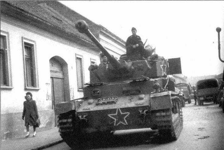 Tankers 1st Bulgarian Army on captured German PzKpfw IV medium tank in the area of the Drava River, Hungary. 1st Bulgarian Army fought in close cooperation with the troops of the 3rd Ukrainian Front, was supplied and rearming of the USSR.