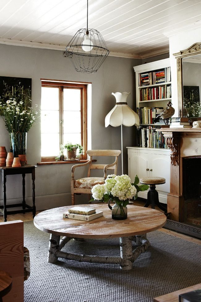 Fresh picked daisies and hydrangea.  Reading room with old and new handmade pieces.