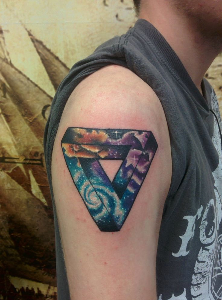 Penrose triangle with space fill, done by Laura Kennedy at Timeless Tattoo, Glasgow