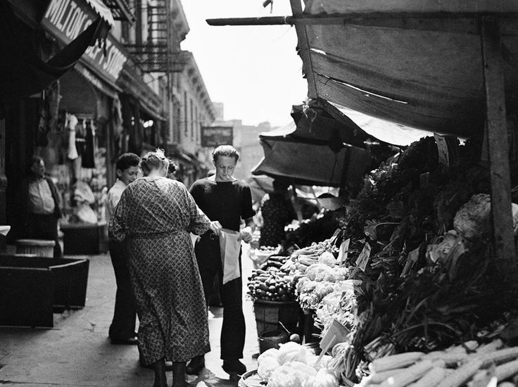 Italian vegetable sidewalk stand, on Bleeker Street, near Church of Our Lady of Pompeii, in August of 1937.