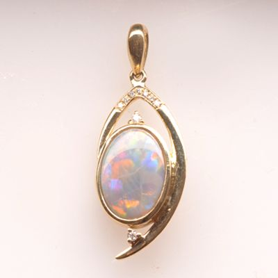 Natural Solid Semi Black Opal Gold Pendant. Vibrant Flashing Colours. Great Quality! This is a fantastic beautiful pendant.