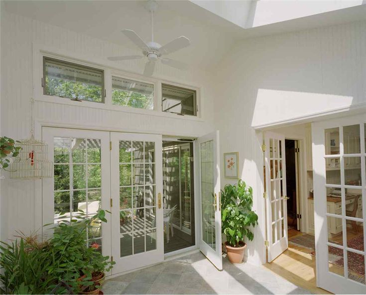 replace garage door with transom windows and french doors?