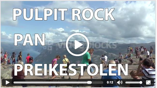 A pan from the Pulpit Rock, Preikestolen, overviewing all the tourists relaxing there.
