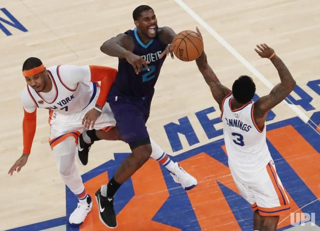 New York Knicks Carmelo Anthony, Brandon Jennings and Charlotte Hornets Marvin Williams reach for a loose ball in the 4th quarter at…