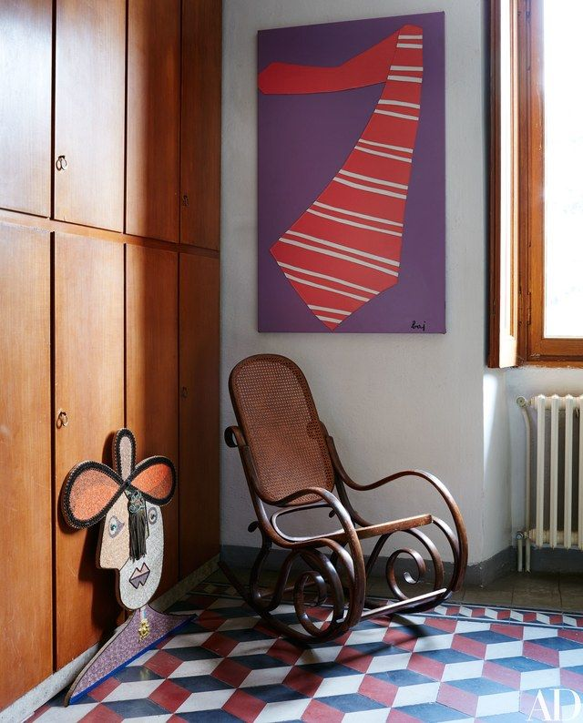 Baj's The Large Tie hangs above an antique Thonet rocking chair.