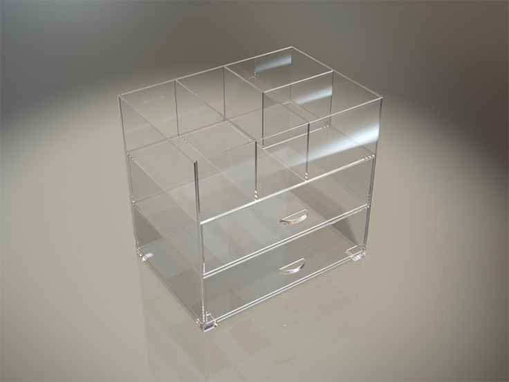 Counter top storage organizer. This organiser is manufactured in high quality clear Plexiglas acrylic and is designed with an open top storage area with multiple divisions allowing for storage of large items. The unit incorporates two storage draws below each having two lose fitting slide inserts for your own personal storage layout. All edges are diamond polished clear with smooth finished.