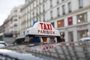 Taxi sign in Paris - Ursula Alter/Photographer's Choice RF/Getty Images