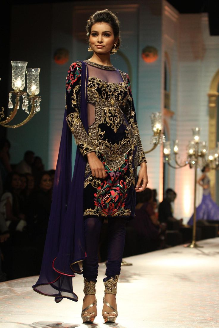 Deep purple with gold embroidery from Mandira Wirk at Aamby Valley India Bridal Fashion Week 2013 in Mumbai (Photo: IANS)
