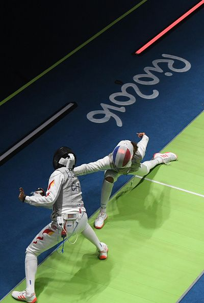 #RIO2016 France's Ysaora Thibus competes against China's Le Huilin during their women's individual foil table of 16 bout as part of the fencing event of the...