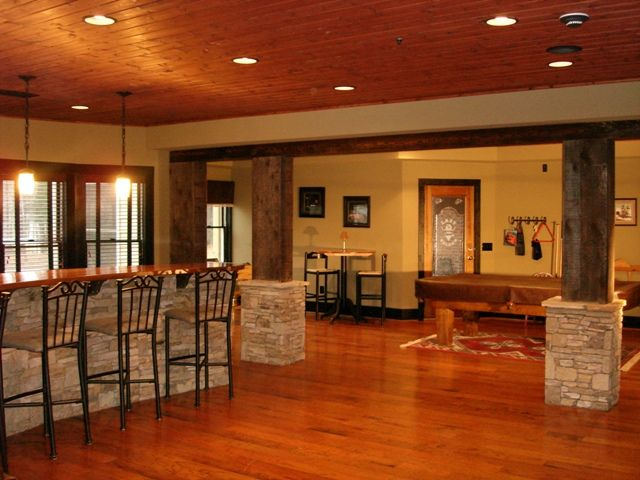 Finished basement with wood floors basement wooden for Modern finished basements