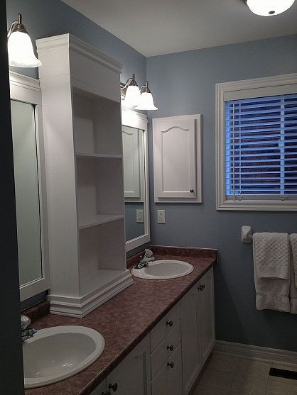 Large Bathroom Mirror redo to double framed mirrors and cabinet- cabinet started at backsplash and molding was added on bottom due to beveled backsplash.