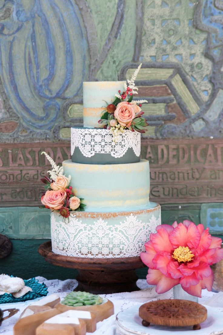 Blue nearly naked cake with lace and flowers