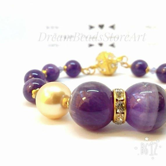 US26.00 Dark purple amethyst Swarovski gold pearl Amethyst bangle Purple gold bracelet Swarovski bicone Rhinestone rondelle Daily jewelry Elegant bangle Evening bracelet Best holiday gift Gift from daughter Ideal gift for her Xmas gift idea   Dark purple amethyst bangle with Swarovski gold pearls looks very attractive! Elegant bangle could be the best holiday gifts! It is a great Xmas gift idea, lovely gift from daughter for mom or ideal gift for her! Also you can wear this daily jewelry...