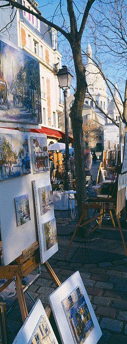 Artwork in Place du Tertre with Basilique Du Sacre Coeur in the background, Paris (Montmartre)