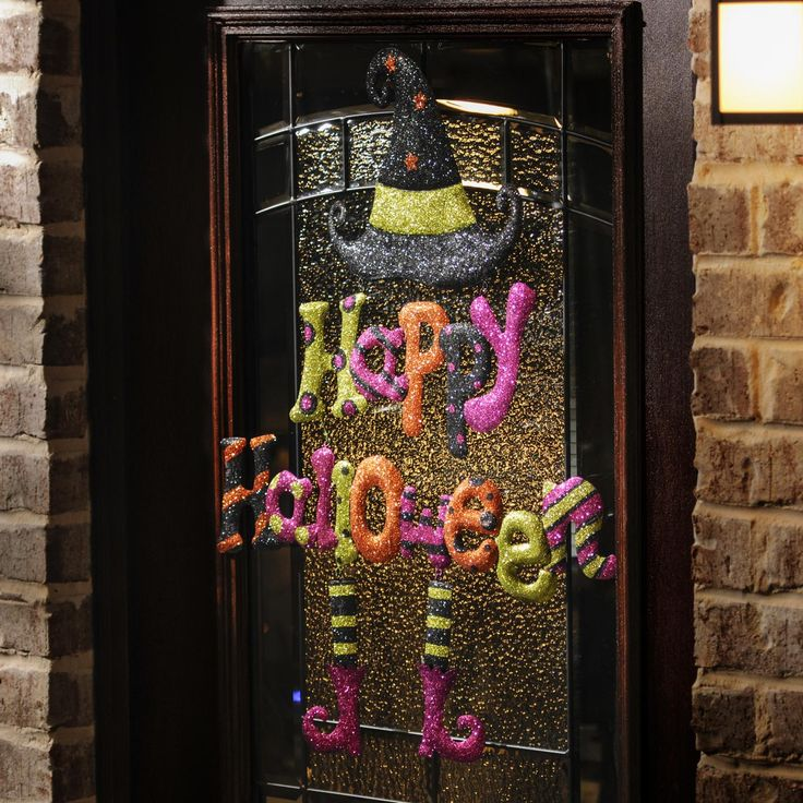 decorate your home for halloween with this happy halloween hanging sign