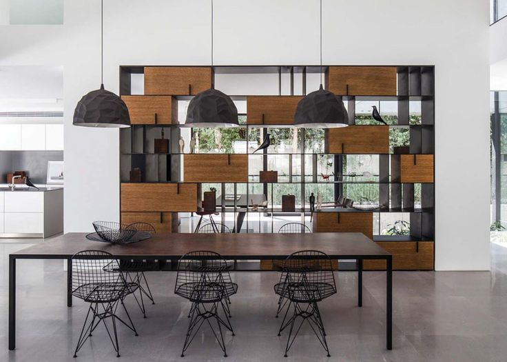 Furniture collection including a shelving system that references a rock formation.