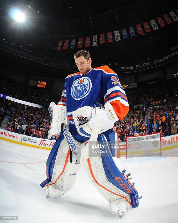 Cam Talbot #33 of the Edmonton Oilers stands for the singing of the national anthem prior to a game against the Los Angeles Kings on December 29, 2015 at Rexall Place in Edmonton, Alberta, Canada.