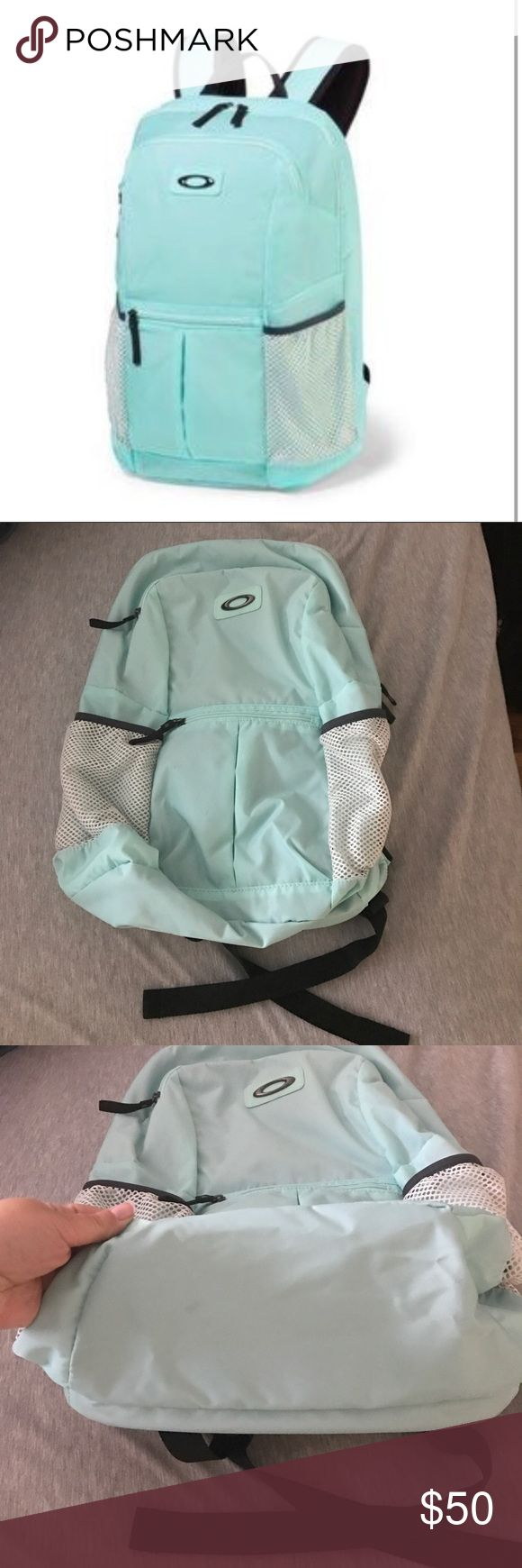 FINAL OFFER- Authentic Oakley Performance Backpack Authentic Oakley Performance Backpack  Color- Teal and black, mesh pockets for water bottle are white  Padded shoulder straps. Storage compartment for a laptop. Side has two water bottle pockets  Lots of compartments and pockets See pictures for some small black spots (nothing even really noticeable but I would like to point them out before purchase)  Comfortable backpack and cute colors 😊 Used once, in amazing condition. Oakley Bags…