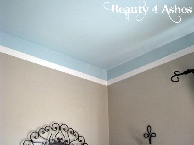 "Crown Molding, Decorative Trim and Duct Tape:  This woman used white duct tape to ""finish"" the look instead of crown moulding.  Looks simple and certainly fooled me!"