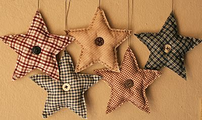 Cut fabric in the shape of a star, hand stitched two pieces together, stuffed them, and then pop a button on them.