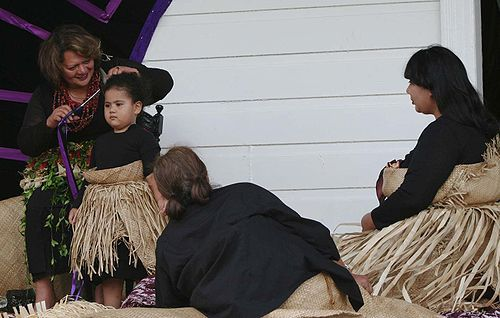 21st c. Tongan mourning dress: a person's hair is sacred and many custom's of respect relate to it in Tongan culture. These women are having their hair cut as part of mourning custom.... from wikipedia