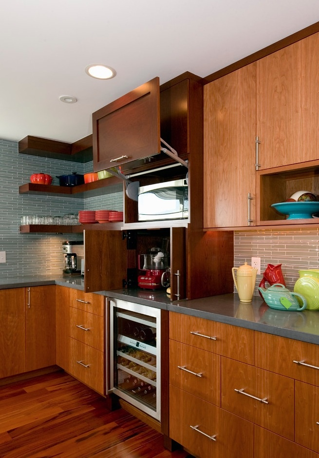Gull wing door to hide microwave. Back-splash tiles. Cabinet color. Chunky floating shelves