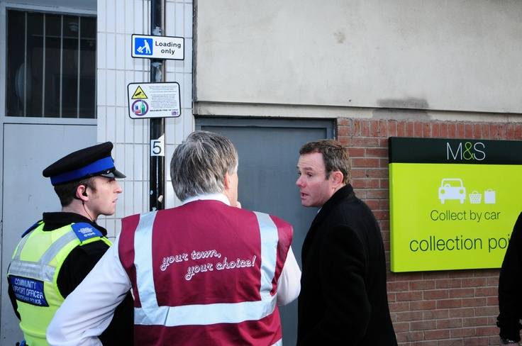 Home Office Minister for Policing and Criminal Justice Nick Herbert discusses the alcohol enforcement zone with PCSO Matt Slemensek and Peter Cutts, Warwick District Council.