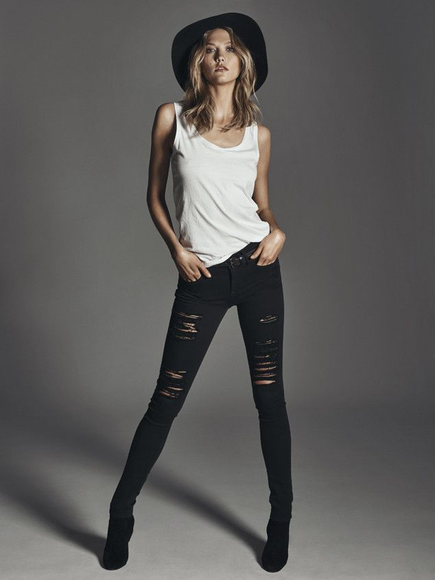 Karlie Kloss wearing black ripped jeans and a white vest top   // fashion pose