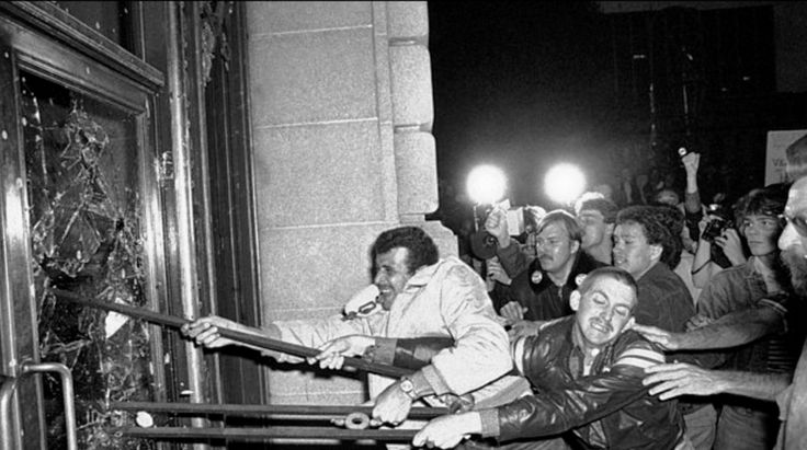 FILE - In this May 22, 1979 file photo, demonstrators smash glass out of the front doors of the San Francisco City Hall. Thousands marched from the city's gay community to city hall, protesting the voluntary manslaughter conviction of Dan White in the fatal shootings of Mayor George Moscone and city supervisor and gay rights activist Harvey Milk.   __   (AP Photo/Paul Sakuma)