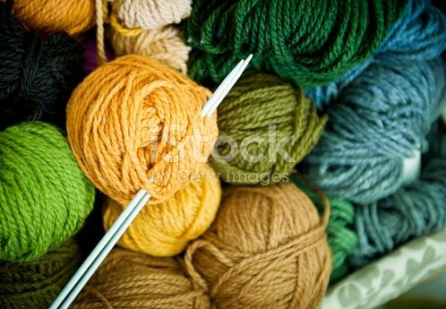 Close up of new wool and knitting needles in the big basket. Studio shot, converted from Nikon RAW.