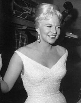PEGGY LEE (1920 - 2002)  American jazz and popular music singer, songwriter, composer, and actress in a career spanning six decades. From her beginning as a vocalist on local radio to singing with Benny Goodman's big band, she forged a sophisticated persona, evolving into a multi-faceted artist and performer. She wrote music for films, acted, and created conceptual record albums—encompassing poetry, jazz, chamber pop, and art songs.