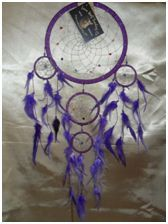 Decorative Bead/Feather Dream Catcher (Medium): A beautiful medium dream catcher with stunning decadent beads set in silver or gold webbing, measuring 20cm in diameter.  This dream catcher comes in various amazing colours.      Choose from Red, Royal Blue, Pink, Purple and Aqua.
