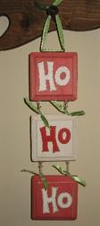 Ho, Ho, Ho Christmas Decor: Use wood squares and glue scrapbook paper to them. Use vinyl letters or paint the Ho, Ho, Ho. Attach with ribbon. Hang vertically or horizontally with ribbon and bows