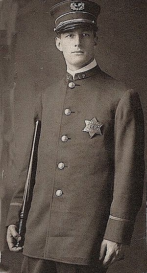 LAW AND ORDER: Portrait of a Chicago Police Officer, Lincoln Park beat (hence the LP on his cap and lapels), c.1910's, Chicago.