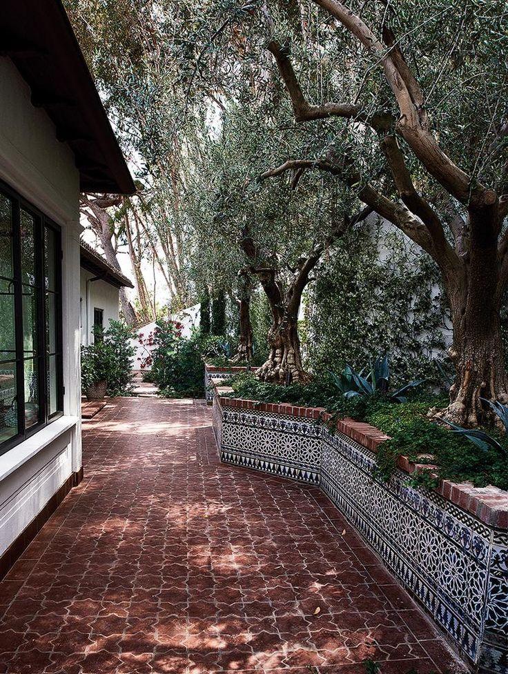A tiled walkway outside the master bath