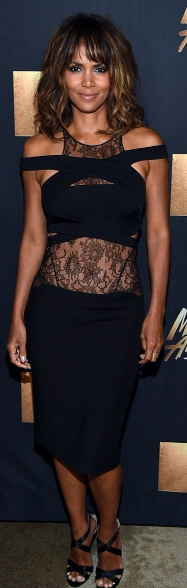 Halle Berry's black lace dress, jewelry, and cross sandals