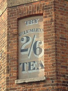 'Try Geo. Lumley's 2/6 Tea' advertising 'ghost sign' ... faded advertising sign painted on wall of building (in bricked up corner window), c. early-mid 20th century, Jericho, Oxford, UK, 2009