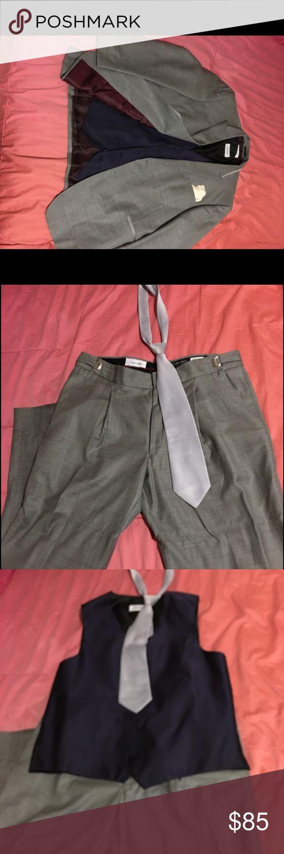 Calvin Klein men's grey suit size XLL Calvin Klein men's suit size XXL w/ light grey tie ,                        Vest - XLL. Blazer -XLL.  Pants - Large (39,40,41) Calvin Klein Suits & Blazers Suits