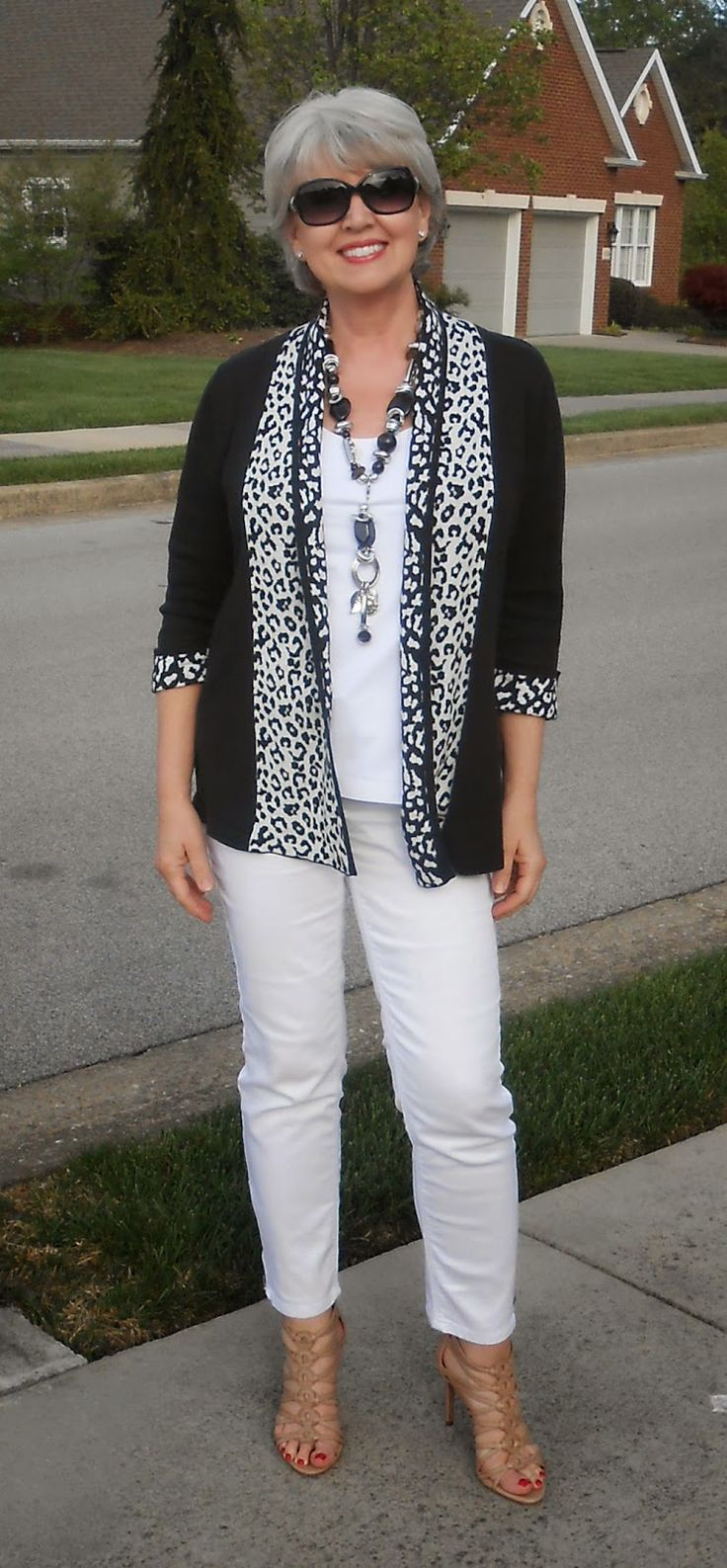 I love this outfit, I always like black & white together, very put together.  Don't like the heels though, to high.
