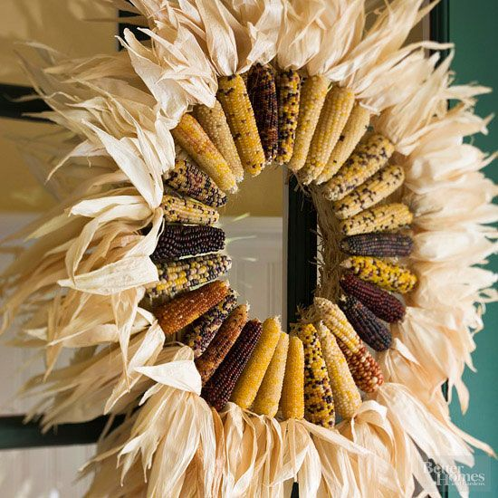 For this festive wreath, Indian corn is arranged in a circle with the shucks pointing out. This golden circle suggests a brilliant fall sun. To make, hot-glue the ears of corn together on a straw wreath and fold the husks outward.