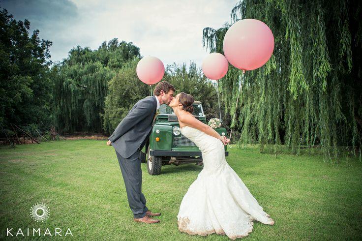 A cute and quirky idea for a picture! #wedding #couple #balloons #landrover #kaimara