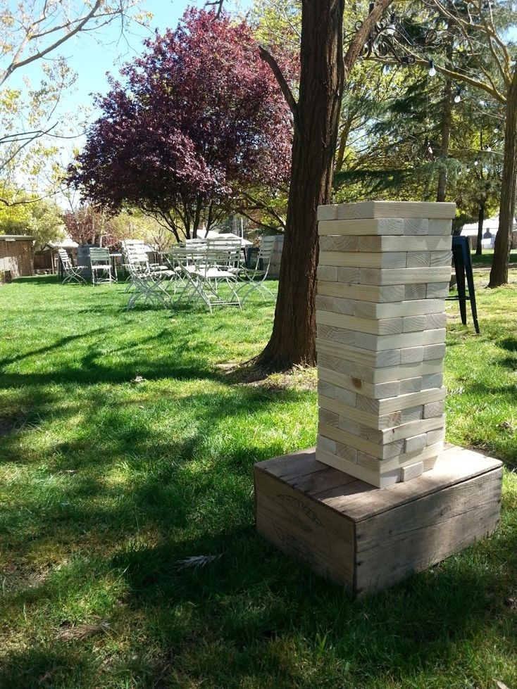 Giant Jenga from Minty Mary Pea Events set-up in the courtyard. Lawn games are a great way to entertain guests after the ceremony.