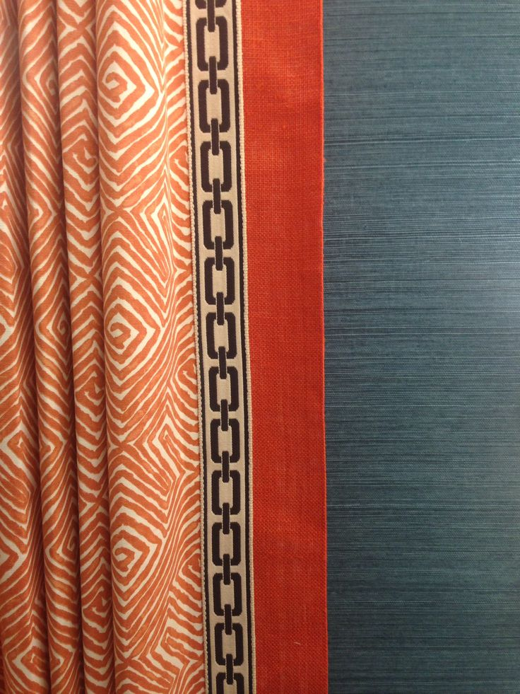 Orange geometric drapery panel w solid banding and  charcoal gray flat braid trim