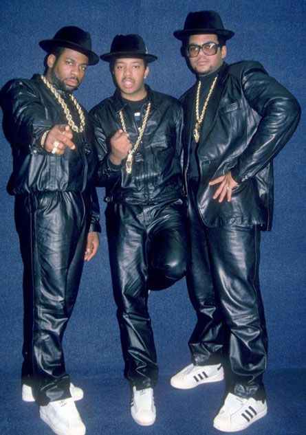 1988-9 The Hip hop genre had just begun and along with the genre of music came a culture of tastemakers. Run DMC (pictured here: Jam Master Jay, Run, DMC) were big influencers in the hip hop world at this time; famous for their all Adidas everything style, leather jackets, leather pants, Lee jeans, gold chains, fedoras, and Cazal eyewear (DMC). (Kee G.)